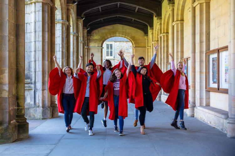 Red-Gowns-Hands-Up-Cloisters-landscape
